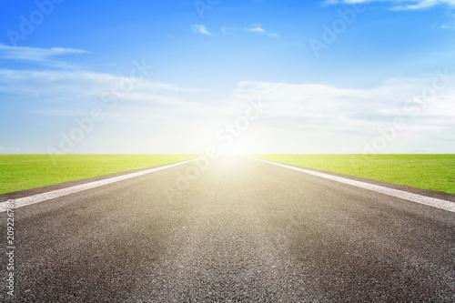 Fotografering  Asphalt road and blue sky background