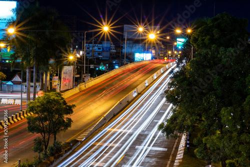 Foto op Plexiglas Nacht snelweg Beautiful scene of The color of Night traffic lights on the Road in Phitsanulok City, Thailand. June 1, 2018