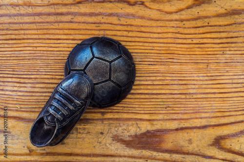 Fényképezés Soccer concept. Football, soccer ball with old soccer cleat