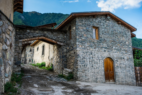 Fotobehang Historisch geb. Typical old stone house with wooden door in Mestia, Georgia. Traditional architecture of Mestia