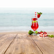 Fresh cold drink on wooden brown table and fresh fruits