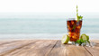 summer drink and sea landscape. Free space for your bottle.