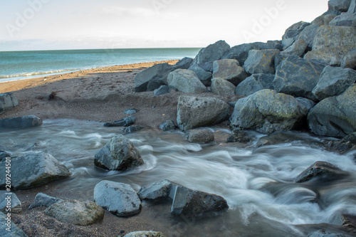 Fotografie, Obraz River Coming to the Sea at Greystones Beach