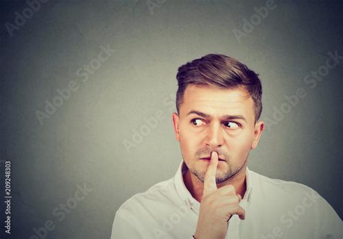 Fotografie, Obraz  Scared man with finger on lips