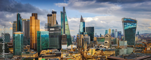 London, England - Panoramic skyline view of Bank and Canary Wharf, central London's leading financial districts with famous skyscrapers and other landmarks at golden hour sunset