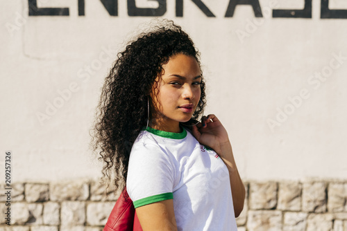 Stylish young ethnic woman with jacket