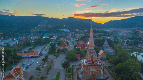 Foto op Aluminium Temple aerial view sunset at beautiful pagoda in Chalong temple Phuket Thailand. Chalong temple is a land mark for tourists. all tourists like to visit Chalong temple
