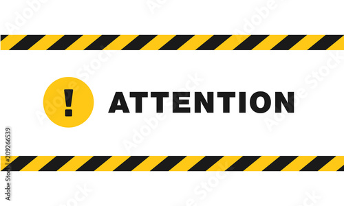 Photo Attention sign between black and yellow striped ribbons isolated on white background
