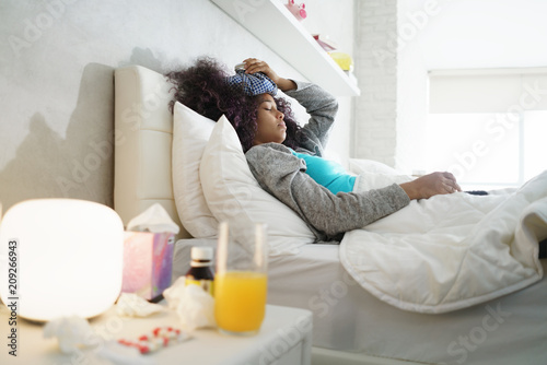 Stampa su Tela Black Woman With Flu And Cold Holding Ice Bag