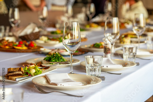 Fototapeta glasses for wine and a beautifully decorated table with snacks in the restaurant