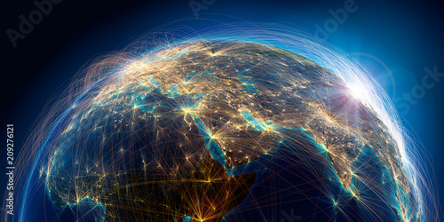 Photo Planet Earth with detailed relief is covered with a complex luminous network of air routes based on real data