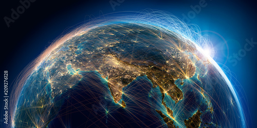 Planet Earth with detailed relief is covered with a complex luminous network of air routes based on real data Wallpaper Mural