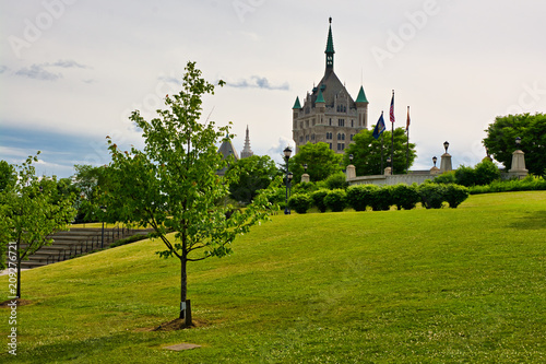 Park and building near corning preserve in Albany New York Tablou Canvas