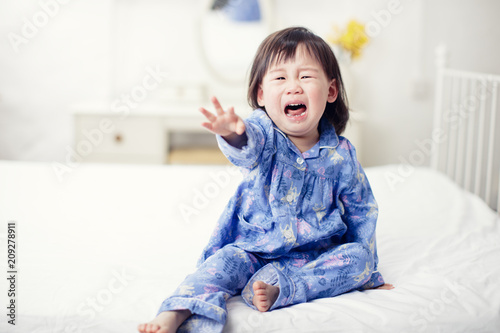 Canvas Print crying baby girl  does not want sleep