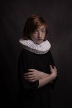Studio Portrait Of Boy Wearing Neck Ruff