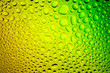 canvas print picture - Close up of a water drops on a green and yellow gradient background, covered with drops of water -condensation.
