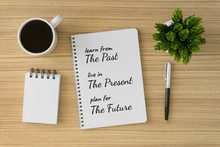 Notebook With Motivational And Inspirational Wisdom Quote On Wood Desk. Learn From The Past, Live In The Present, Plan For The Future.