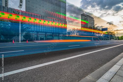 Fototapeta Vehicle light trails in city at night. obraz na płótnie