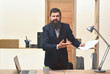 Portrait of angry bearded businessman. Businessman screaming. Angry businessman in suit. Businessman holds paper in hands and scream. Handsome bearded office worker.