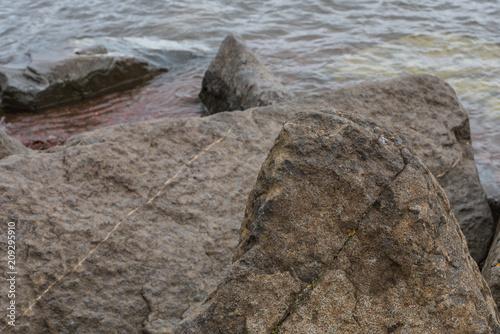 Fotobehang Kust Large Rocks on Shoreline
