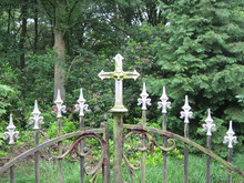 Rusty Gate On A Graveyard