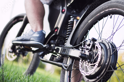 Man biker sitting on electric bike