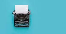 Vintage Typewriter Over Blue B...