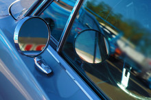 Side Rear-view Mirror And Reflection In The Window On Blue Retro Car