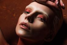 Sensual Girl With Fashionable Red Makeup Looking At Camera