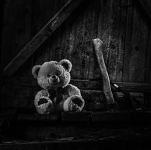 Teddy Bear Sitting In Thrown Shed.