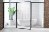 White tub in white and brown bathroom, glass door