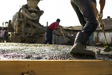 Construction Workers Are Pouri...