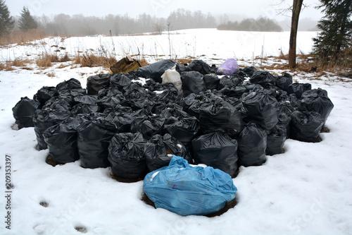 Fototapety, obrazy: stack rubbish trash full  plastic sacks on snow in park