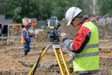 The Surveyor Makes Measurement...