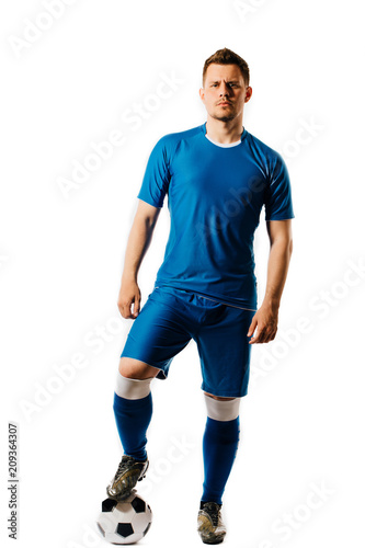Stampa su Tela Young handsome football player with a soccer ball posing isolated on white background