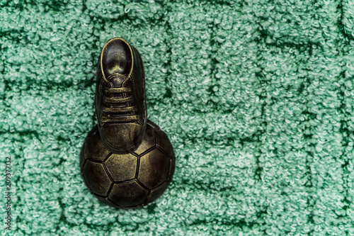 Valokuvatapetti Soccer concept. Football, soccer ball with old soccer cleat