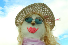 A Scarecrow With Sunglasses. C...
