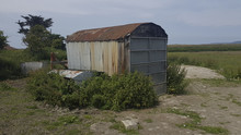 Run Down Old Rusty Corrugated Tin Shed Surrounded By Weeds In A Field Appledore North Devon United Kingdom