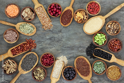 Poster Assortiment Super food with legumes, grains, seeds, berry fruit, cereals, medicinal herbs and spices, pollen grain & nutritional supplement powders, Foods high in antioxidants, anthocyanins, minerals & vitamins.