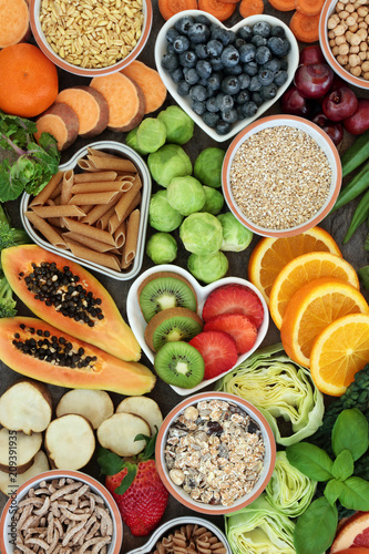 Poster Assortiment Healthy high fibre dietary food concept with whole wheat pasta, legumes, cereals and grains. High in antioxidants, anthocyanins, smart carbohydrates and vitamins. Top view.