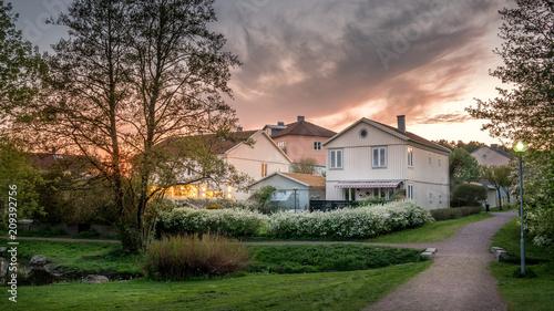 Fotografie, Obraz Sunset lights the houses in Molndal, suburb Gothenburg city, Sweden