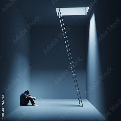 Fototapeta Ein Mann sitzt depressiv in einem Raum mit Leiter