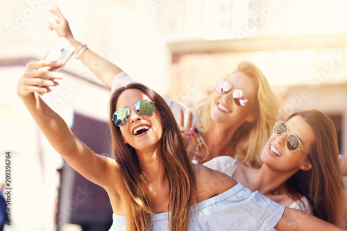 Fotografie, Obraz  Happy girl friends hanging out in the city in summer