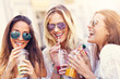 canvas print picture - Happy girl friends hanging out in the city in summer