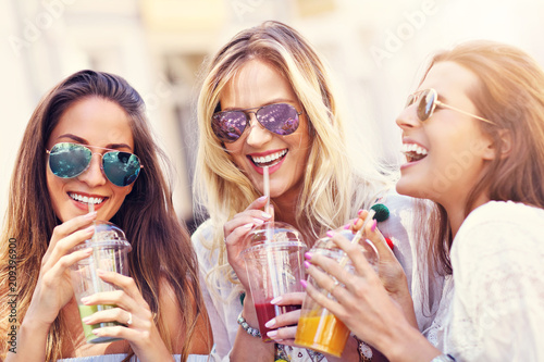 Obraz Happy girl friends hanging out in the city in summer - fototapety do salonu