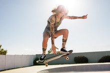 Women Skater Doing Ollie On Sk...