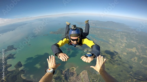 Photo Skydiver point of view above the beach