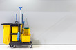 canvas print picture - Mop bucket and set of cleaning equipment and sign of men toilet on the wall in the airport