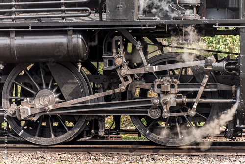 Steam locomotive train wheels - Buy this stock photo and