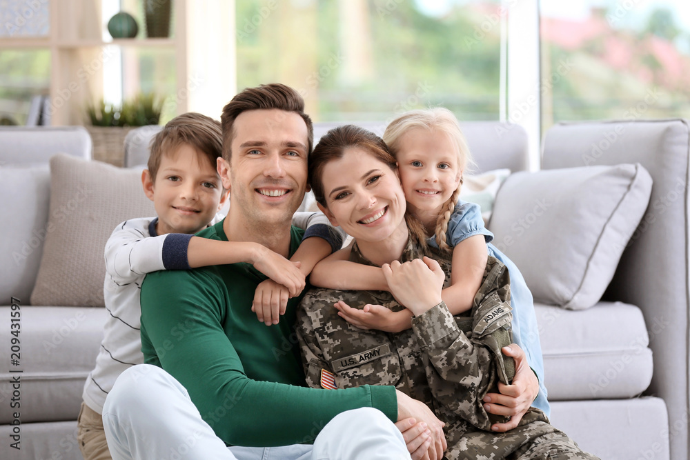 Fototapety, obrazy: Woman in military uniform with her family at home